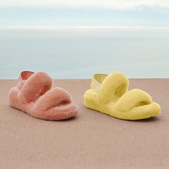 pink and yellow fluffy ugg slippers with a strap around the ankle and two loops over the foot