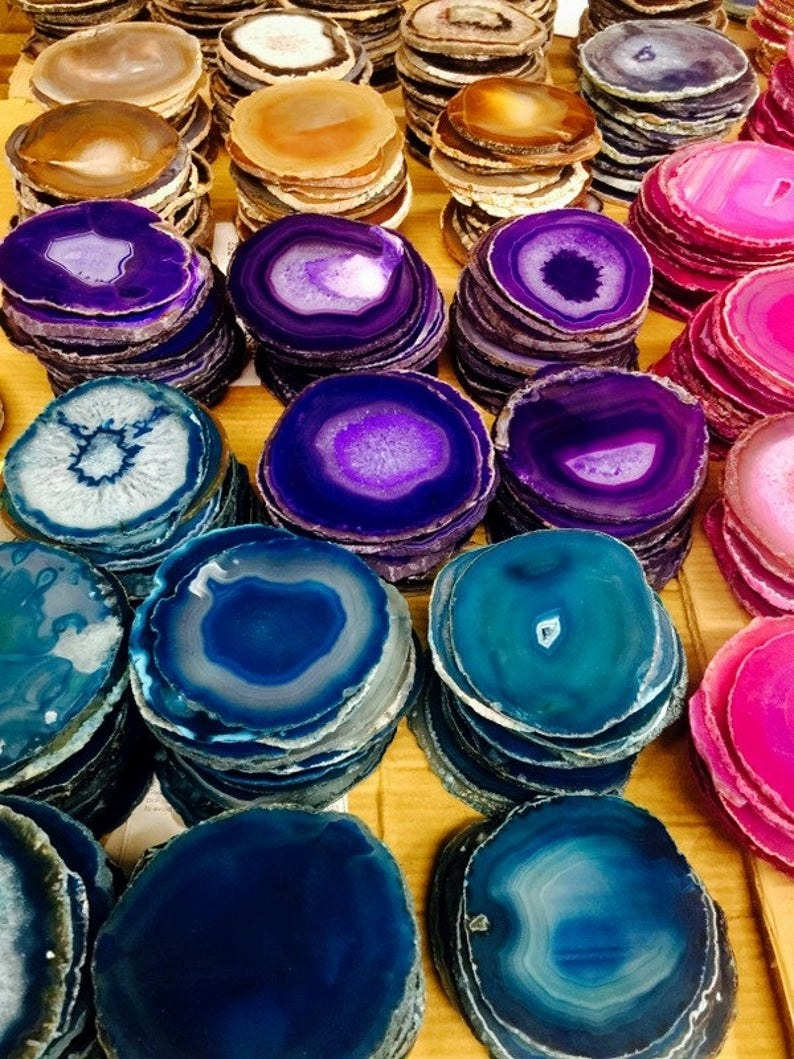 stacks of blue, purple, pink, orange, and natural agate coasters