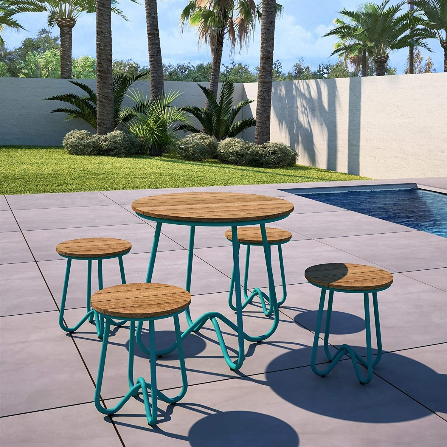 a circular wooden table surrounded by four stools, all have turquoise blue, curvy metal legs attached