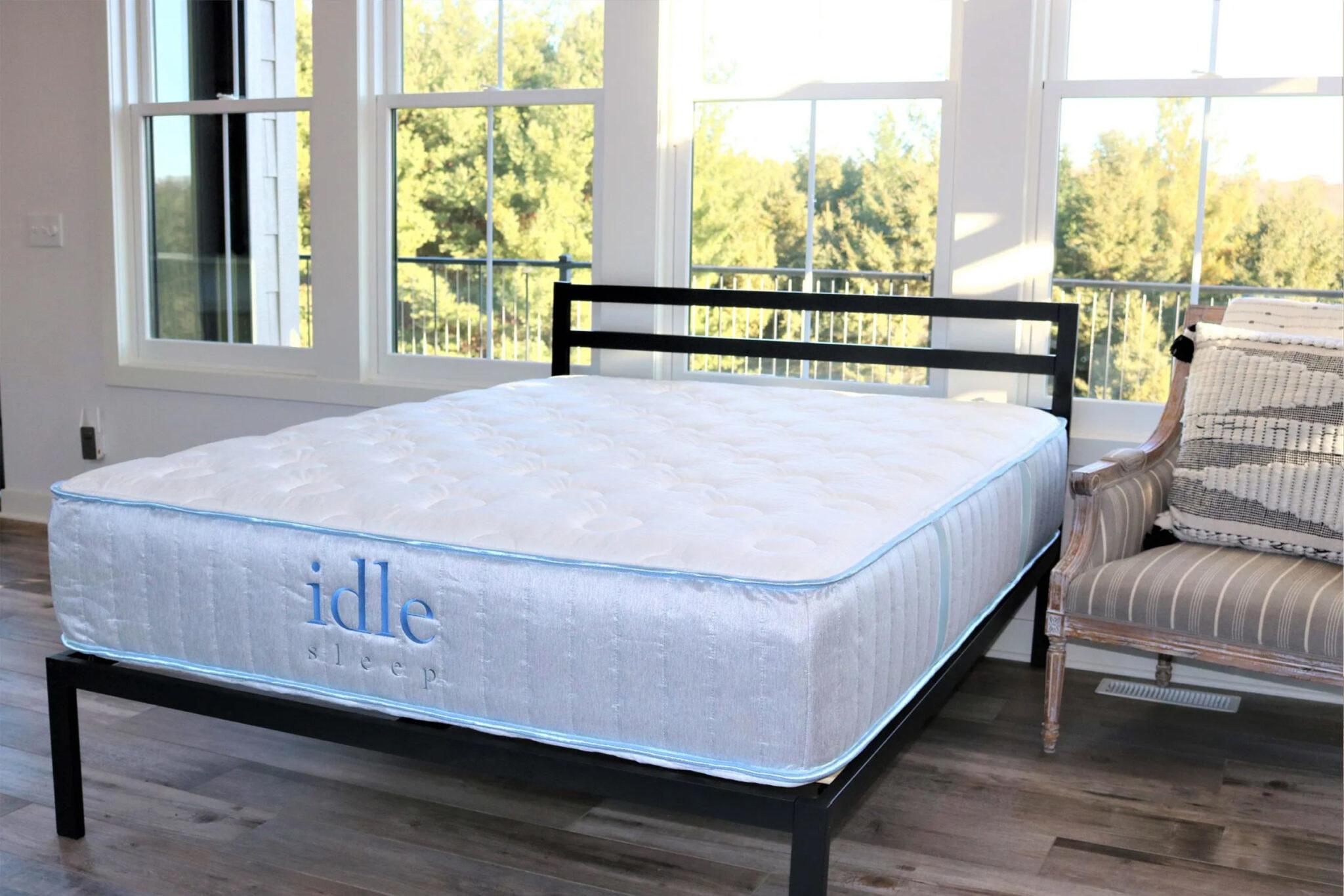 an idle sleep mattress on a bed frame