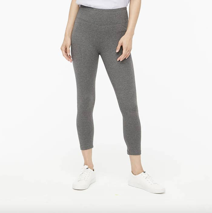 A model's legs showing off the gray version of the leggings