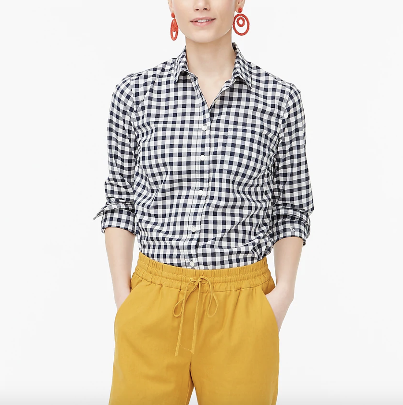 A model wearing the shirt with yellow pants