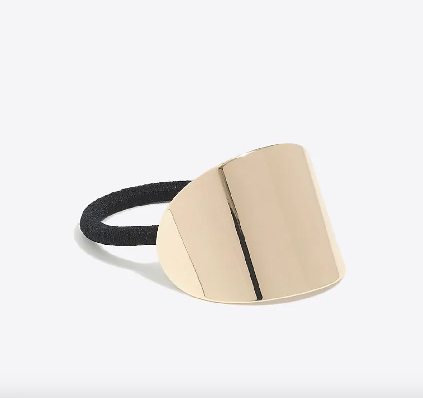 The elastic against a plain background with the gold metal part on show