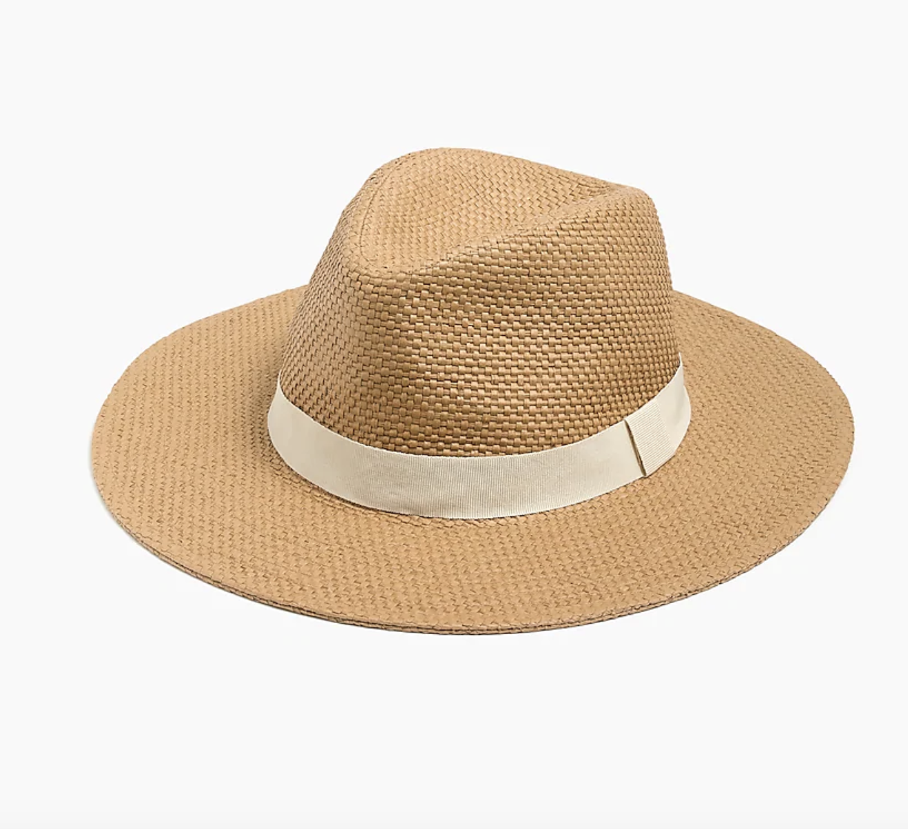A paper straw hat with a cream band against a plain background