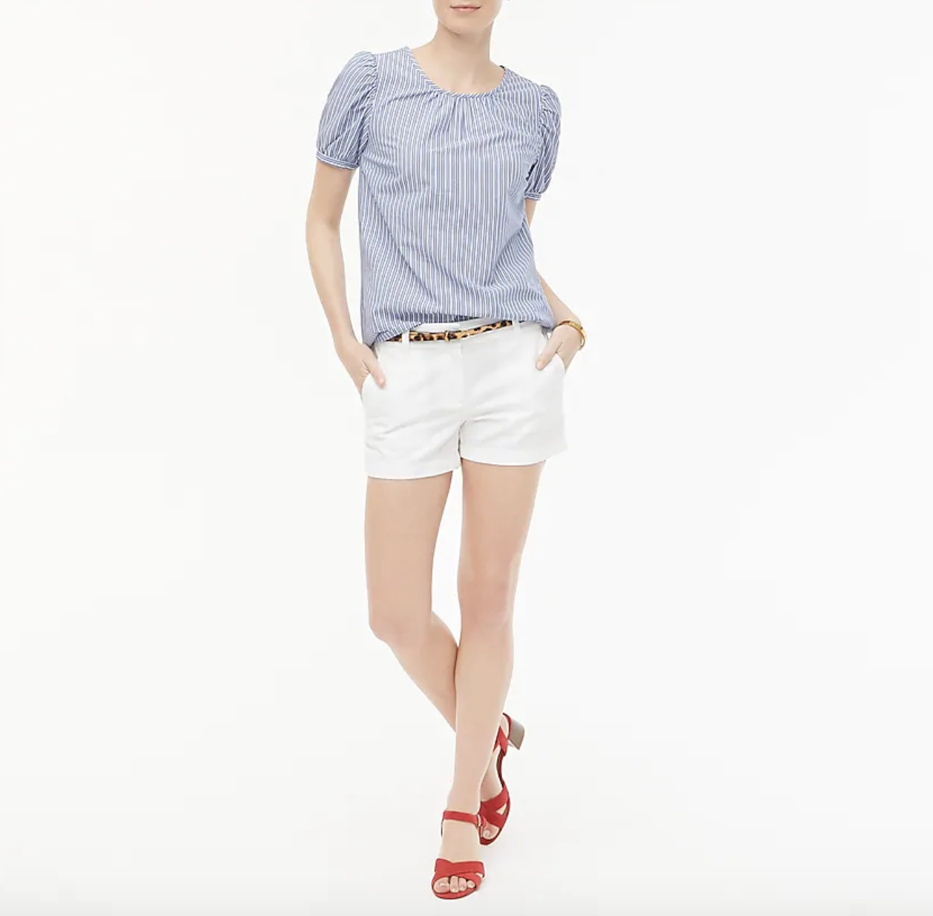 A model wearing plain cotton white shorts, which have a 3.5-inch inseam, with a leopard print belt