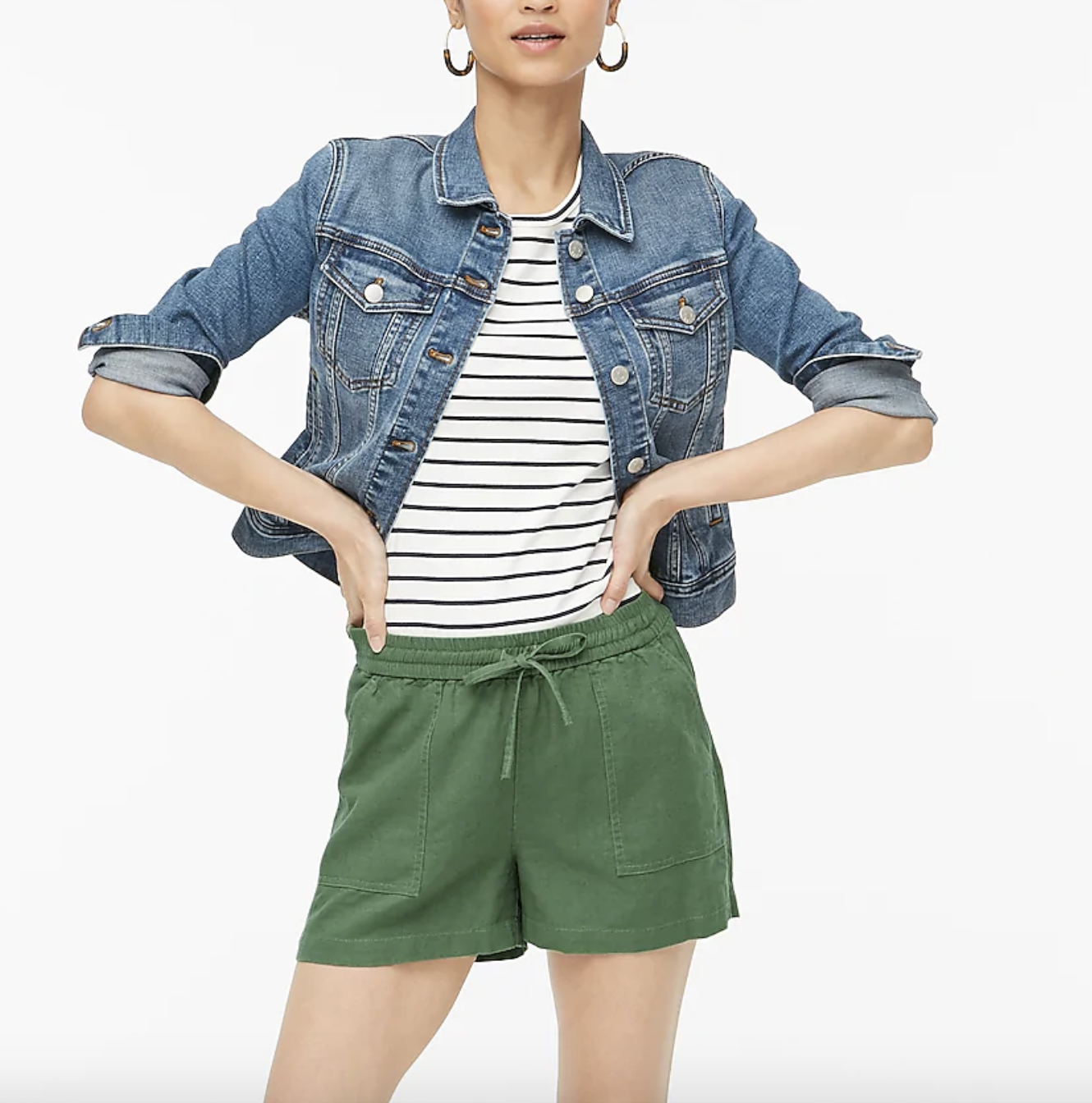 A model wearing the shorts in green