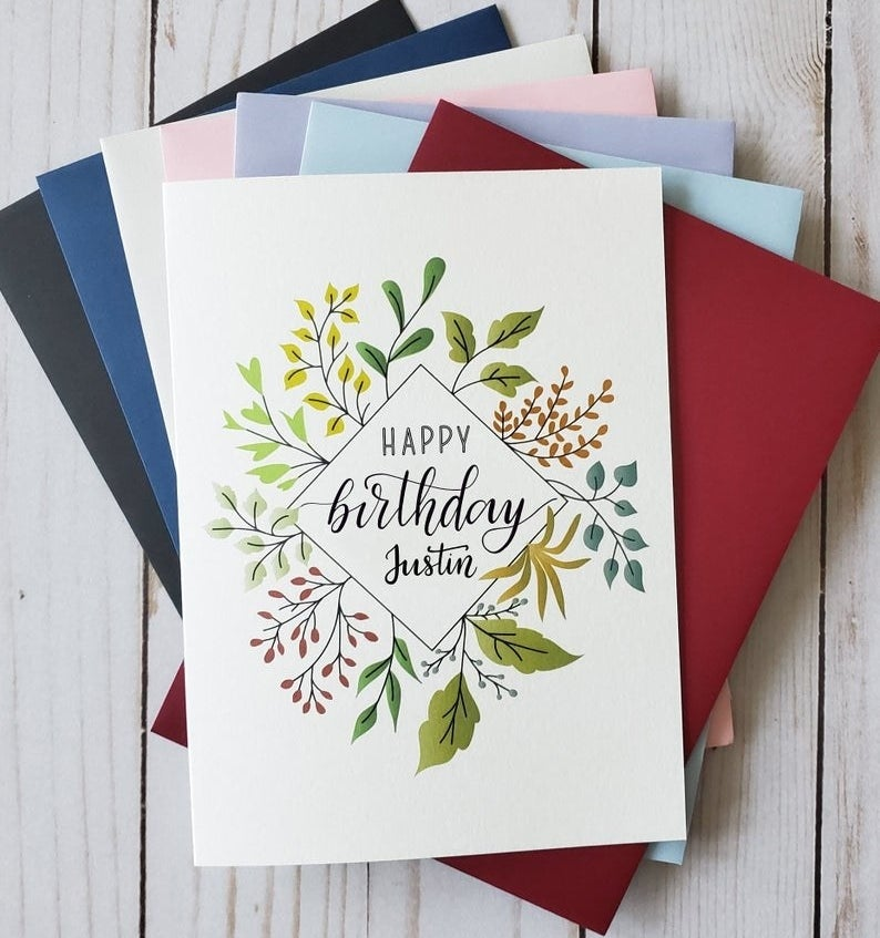 """A card that reads """"Happy birthday"""" and can be personalized by name and has an illustrations of leaves"""