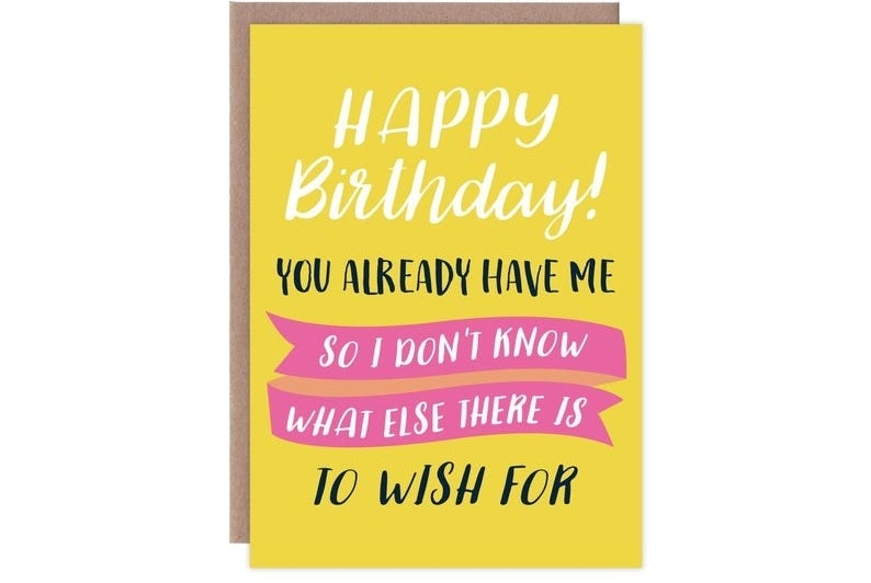 """A yellow, white, black, and pink card that reads """"Happy birthday! You already have me so I don't know what else there is to wish for"""""""