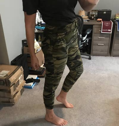 A reviewer wearing the joggers in camo (or army) print