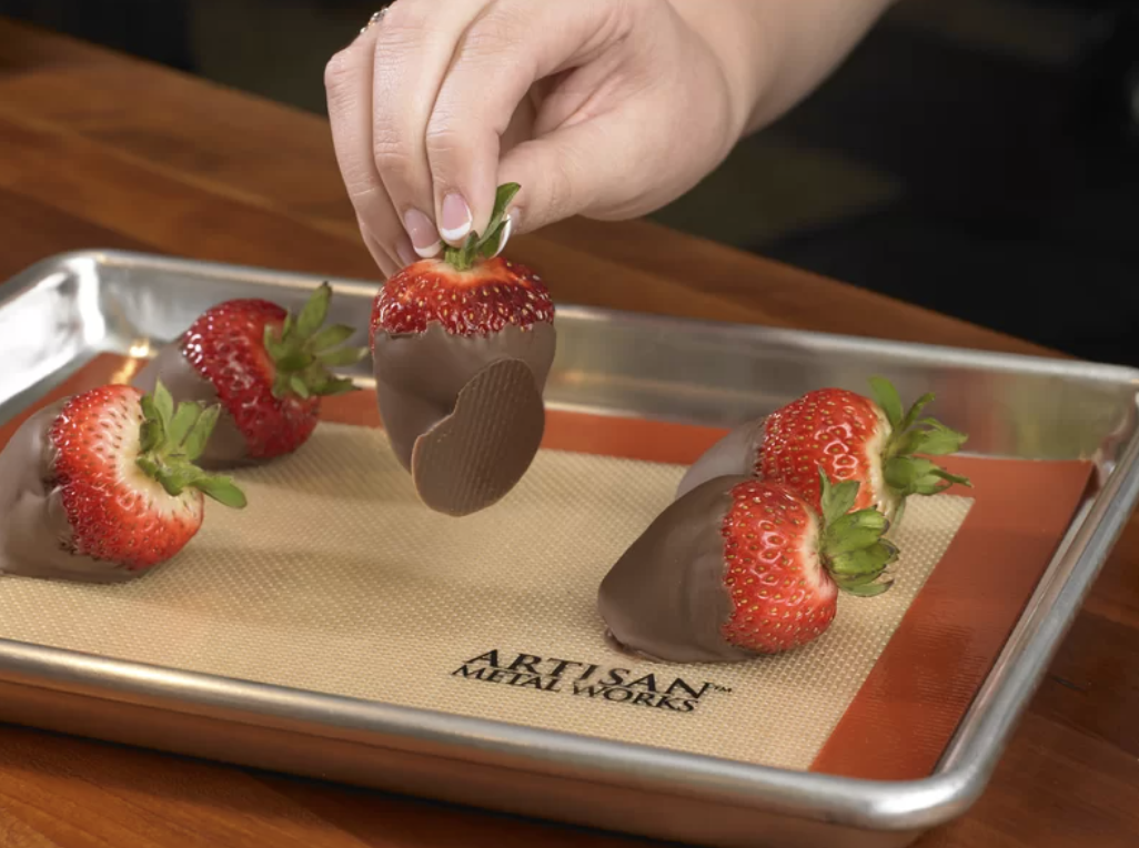 chocolate covered strawberries on top of a baking sheet