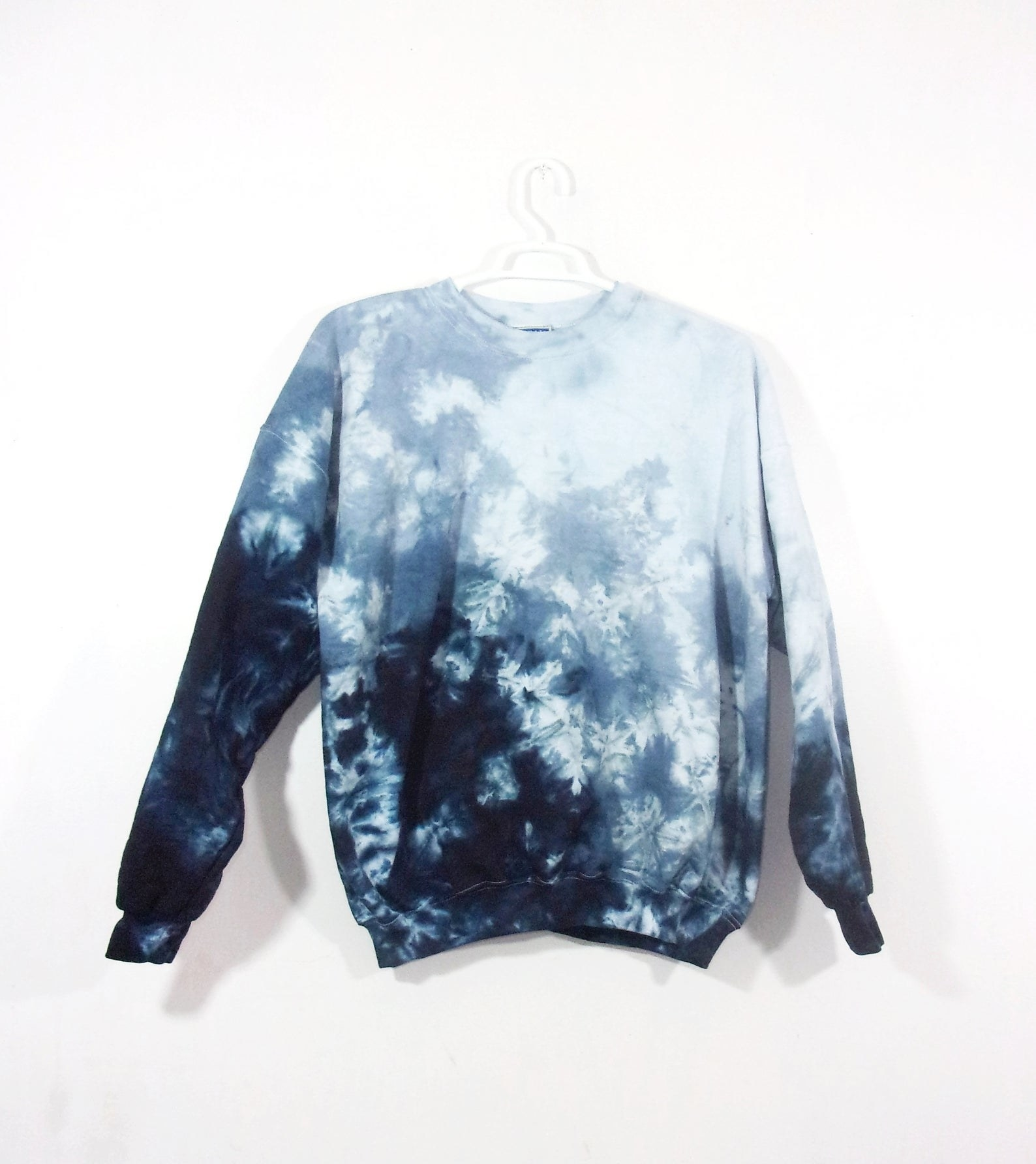 A pullover sweater hand-dyed in a navy blue to light blue gradient