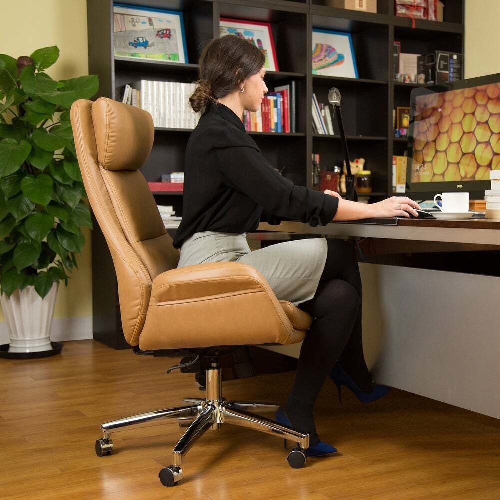 Model sits in the chair while working at a desk