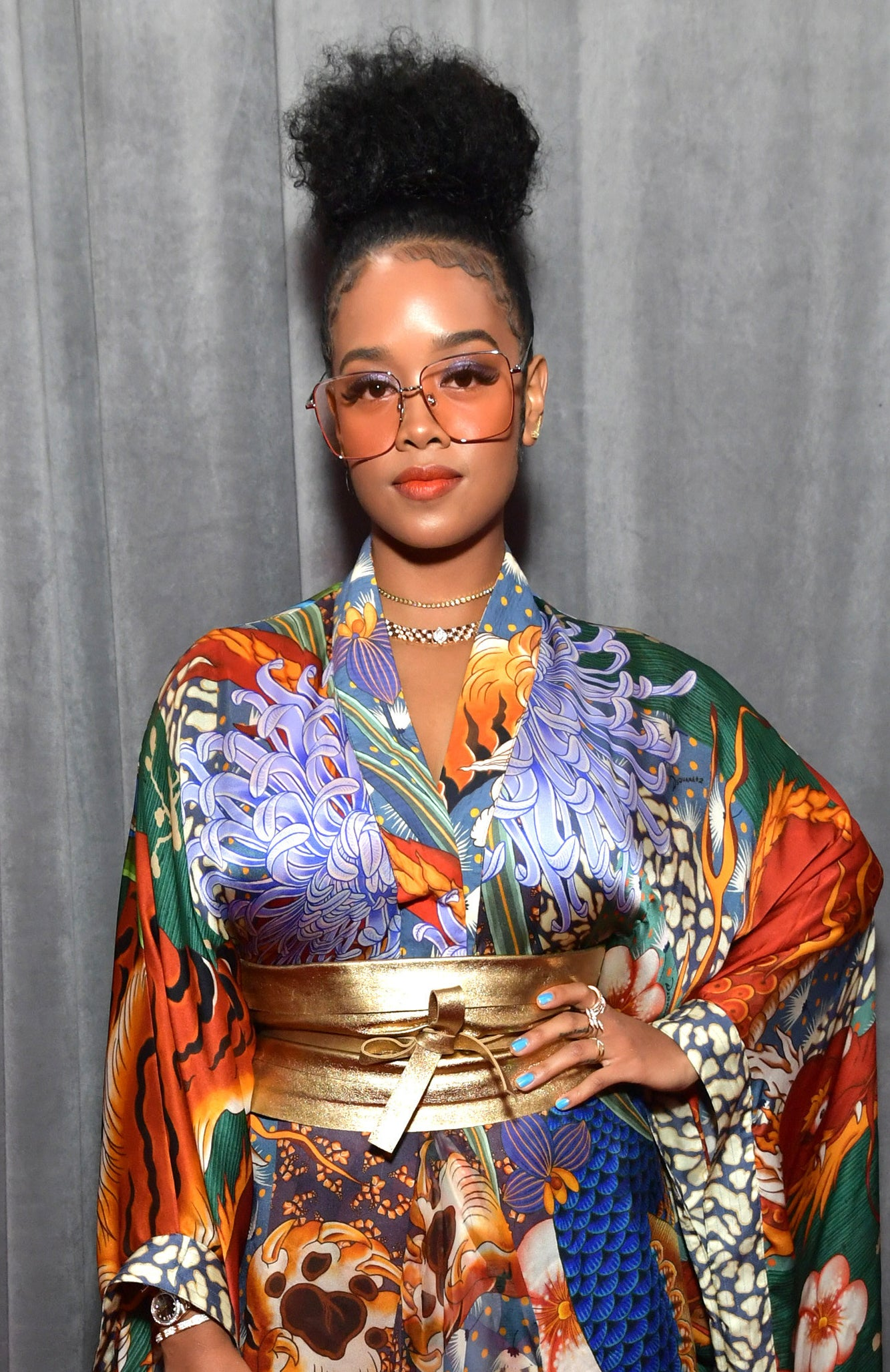 H.E.R. wearing sunglasses and a kimono