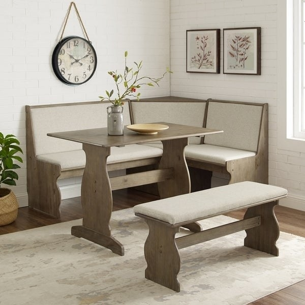 dining area corner with a corner bench with a back, a matching rectangular dining table, and a matching bench with no back
