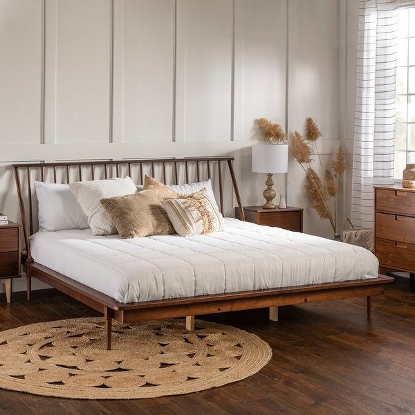 wood platform bed with headboard made of wood spindles, white minimalist bedding