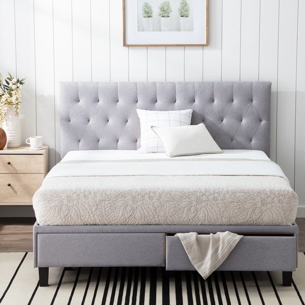 contemporary style light gray upholstered bed frame with tufted headboard and two pull out drawers at the foot of the bed.
