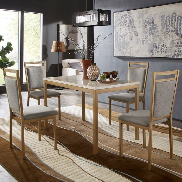 modern rectangular dining table with white faux marble top, wood base and legs. four matching dining room chairs with gray linen cushions and backs