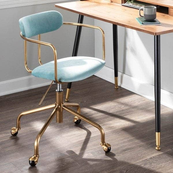 blue velvet and gold metal desk chair with a cushioned seat and back and metal arms