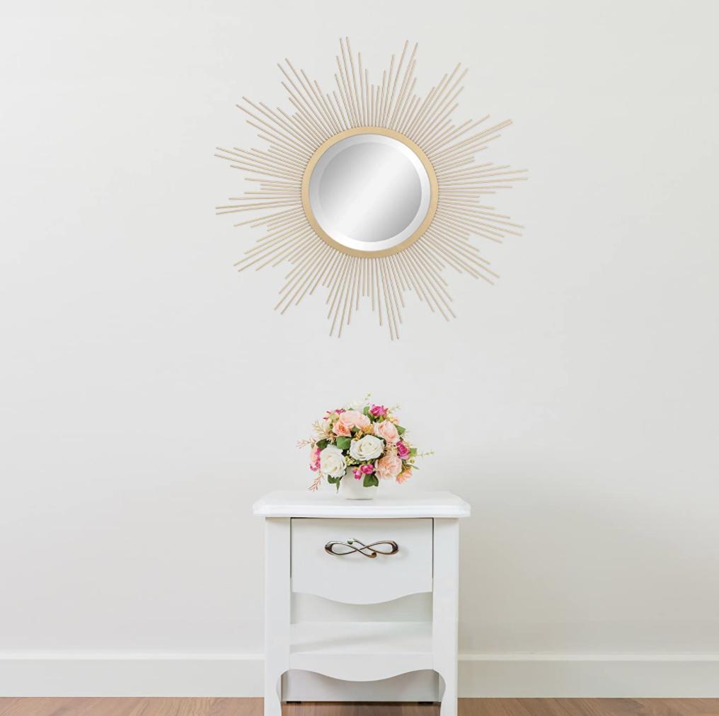 sunburst style mirror on wall