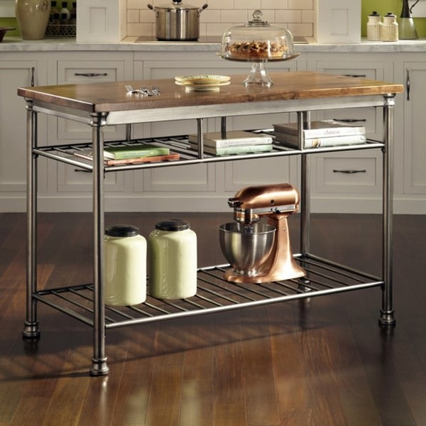 open metal kitchen cart with a wood butcher block tabletop. Three smaller shelves and one large open shelf that'll fit something like a standing mixer