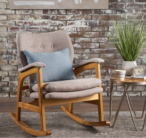 wood rocking chair with gray-beige cushions on seat, back, arm rests