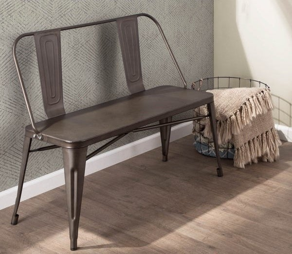 industrial-style metal bench in an antiqued brown color with enough room to seat two and a back with two small panels