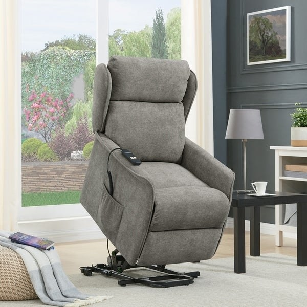 cushioned gray recliner chair with hydraulics to lift it up and forward so the person sitting can more easily get out of it. Has a pocket on the side of the chair to hold the chair's remote control