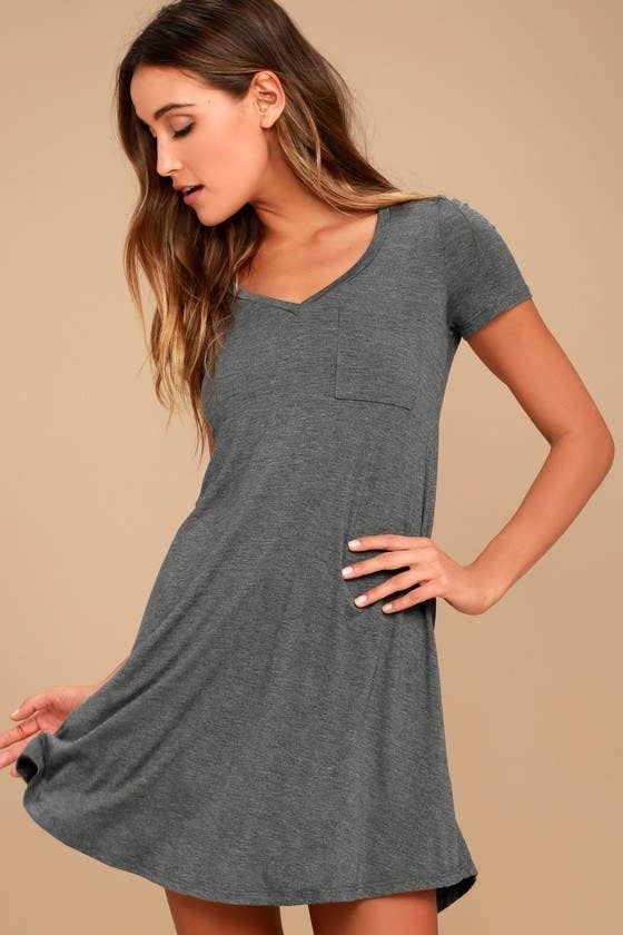 model in a grey flowy v-neck dress with a small chest pocket