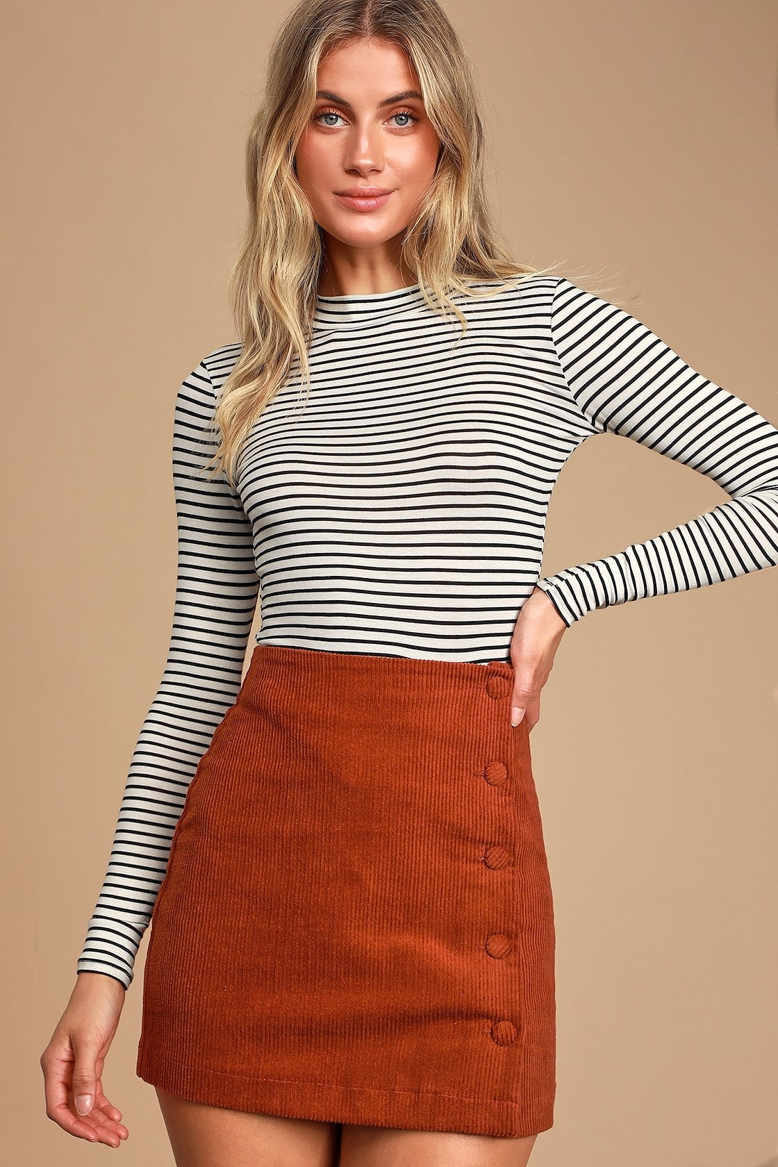 model wearing a long sleeve top with black and white stripes
