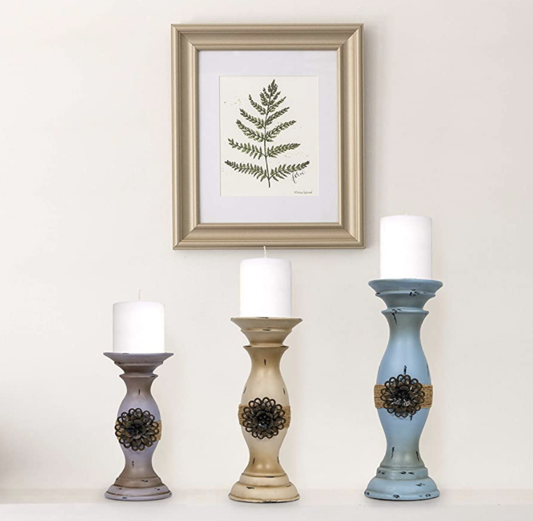 Dark purple, gold, and blue vintage-inspired candle holders on a table