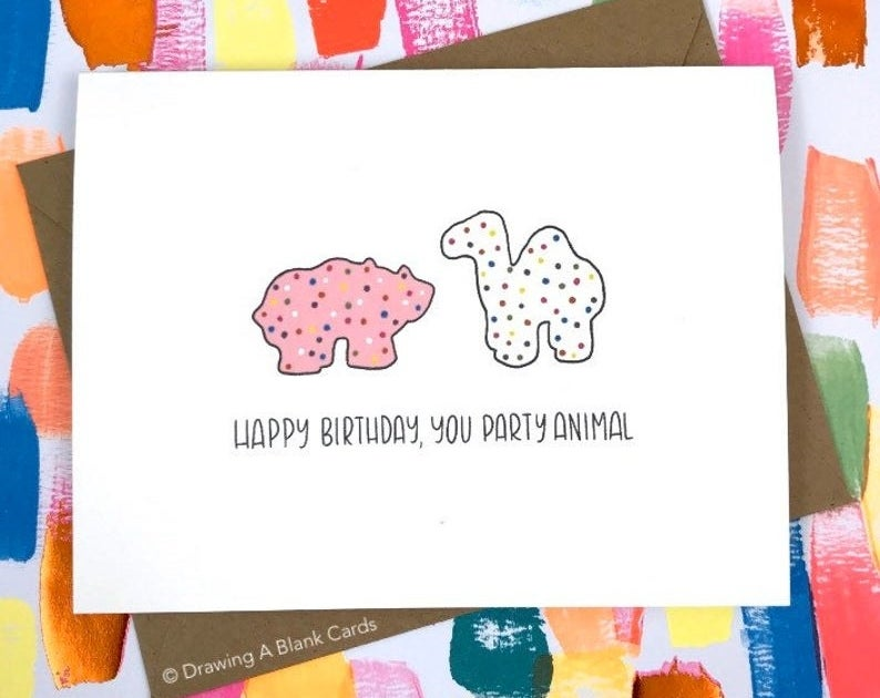 """A card that reads """"Happy birthday, you party animal"""" with illustrated frosted animal crackers"""