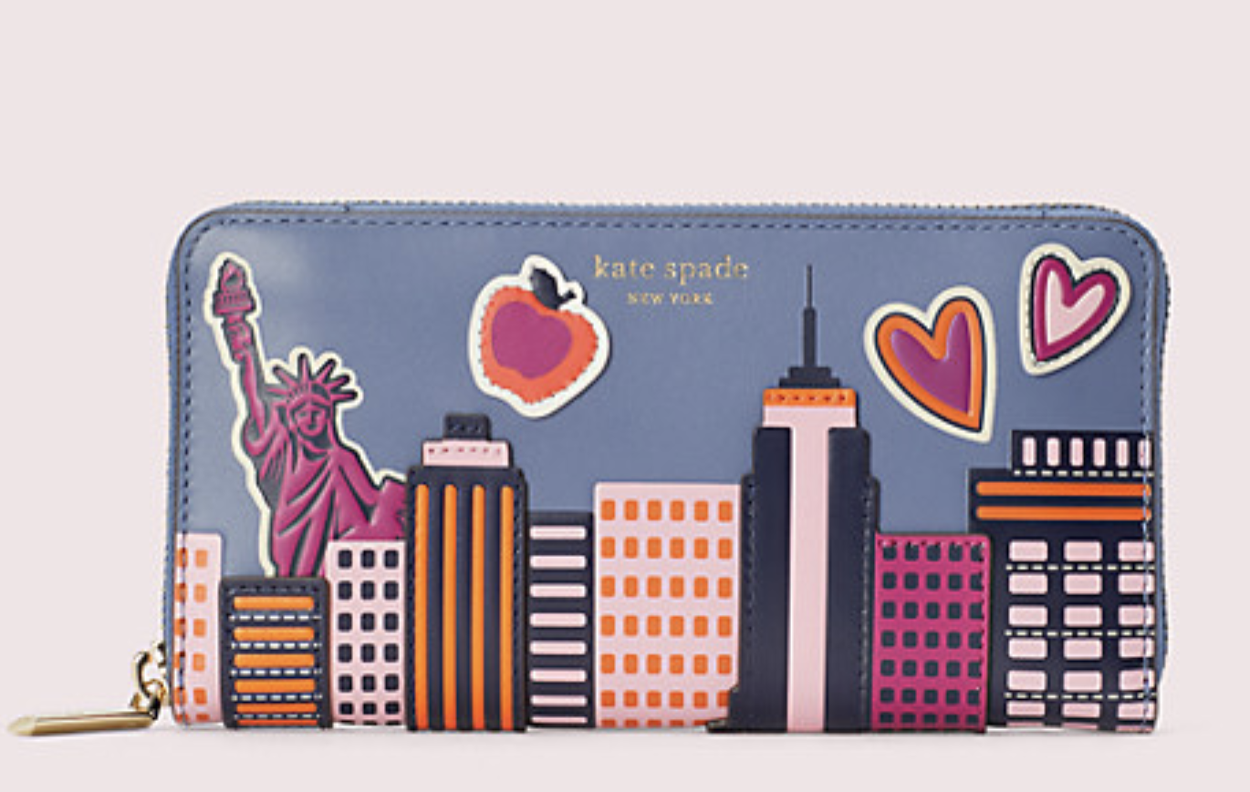 Closeup of the wallet with the colorful skyline, Statue of Liberty, apple, and two hearts