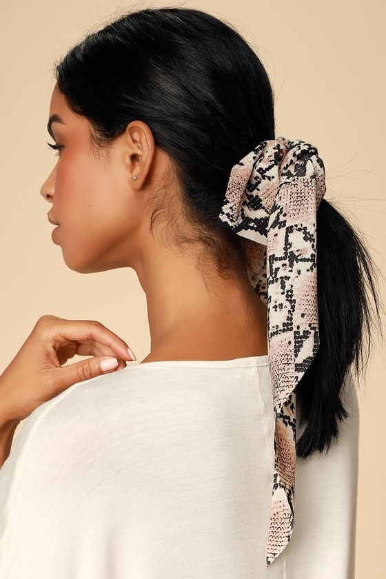 model wearing ponytail with snake print scarf holder wrapped around it