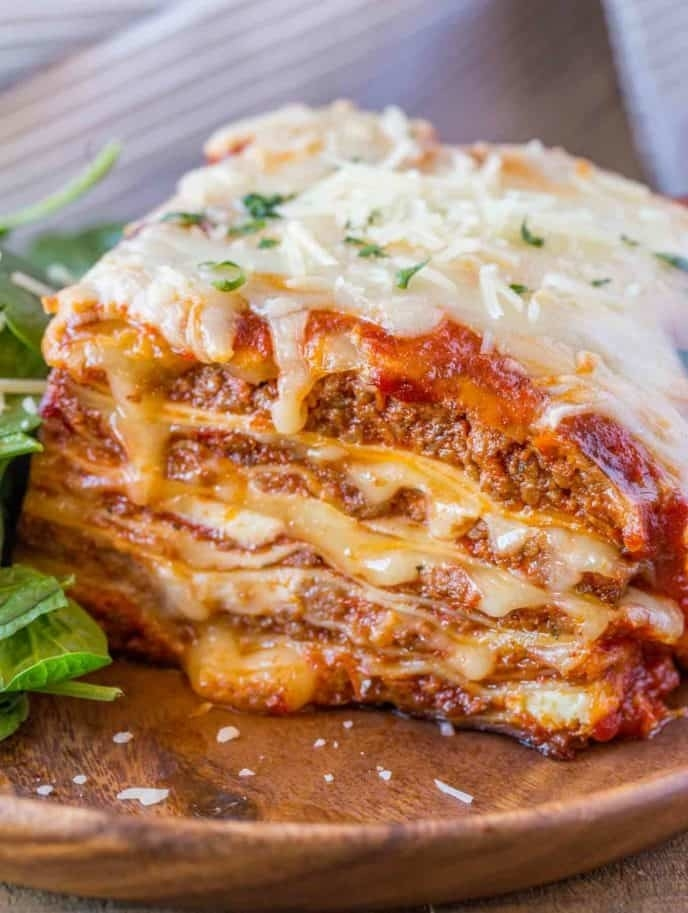 Layered lasagna with meat and cheese.