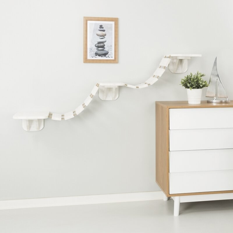 A product shot of the white version of this cat bridge mounted to the wall
