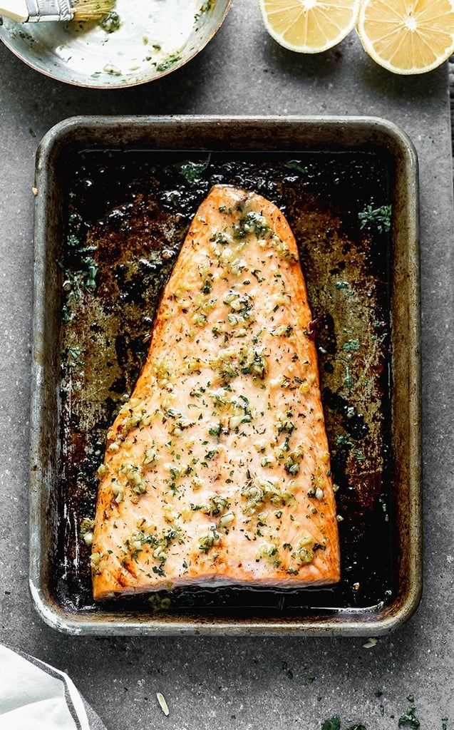 Oven-baked salmon on a sheet pan.