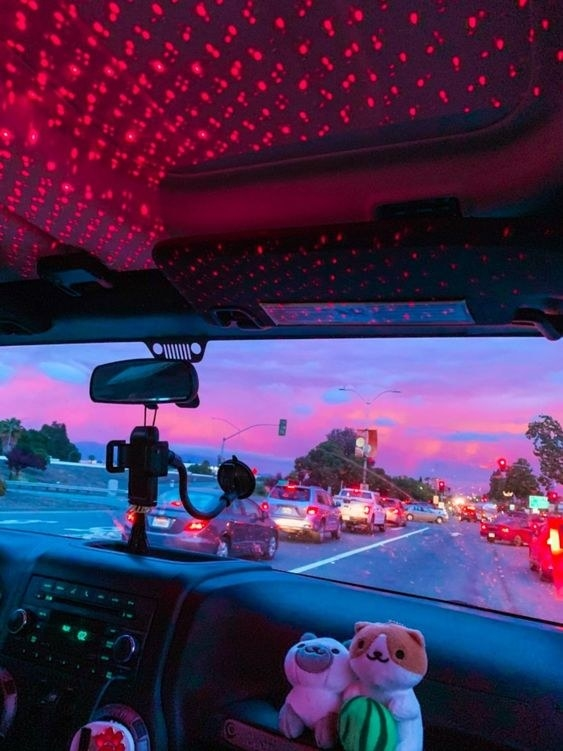 A reviewer's using the star projector in their car