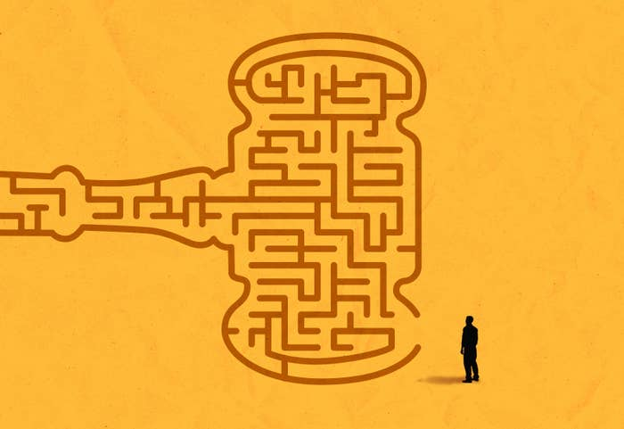 an illustration of man staring at a maze that looks like a judge's gavel