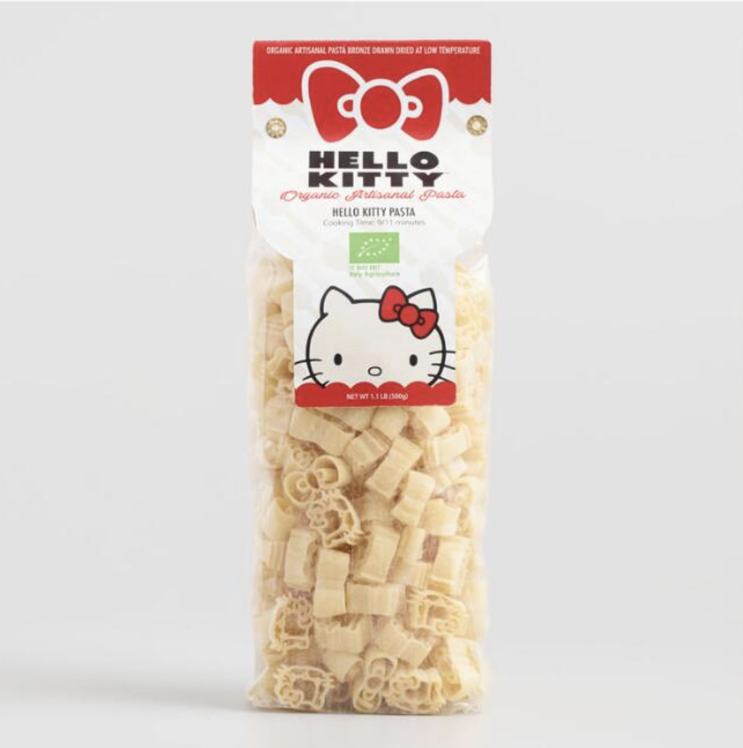 A transparent plastic bag full of pasta shaped like Hello Kitty's face and her iconic hair bow