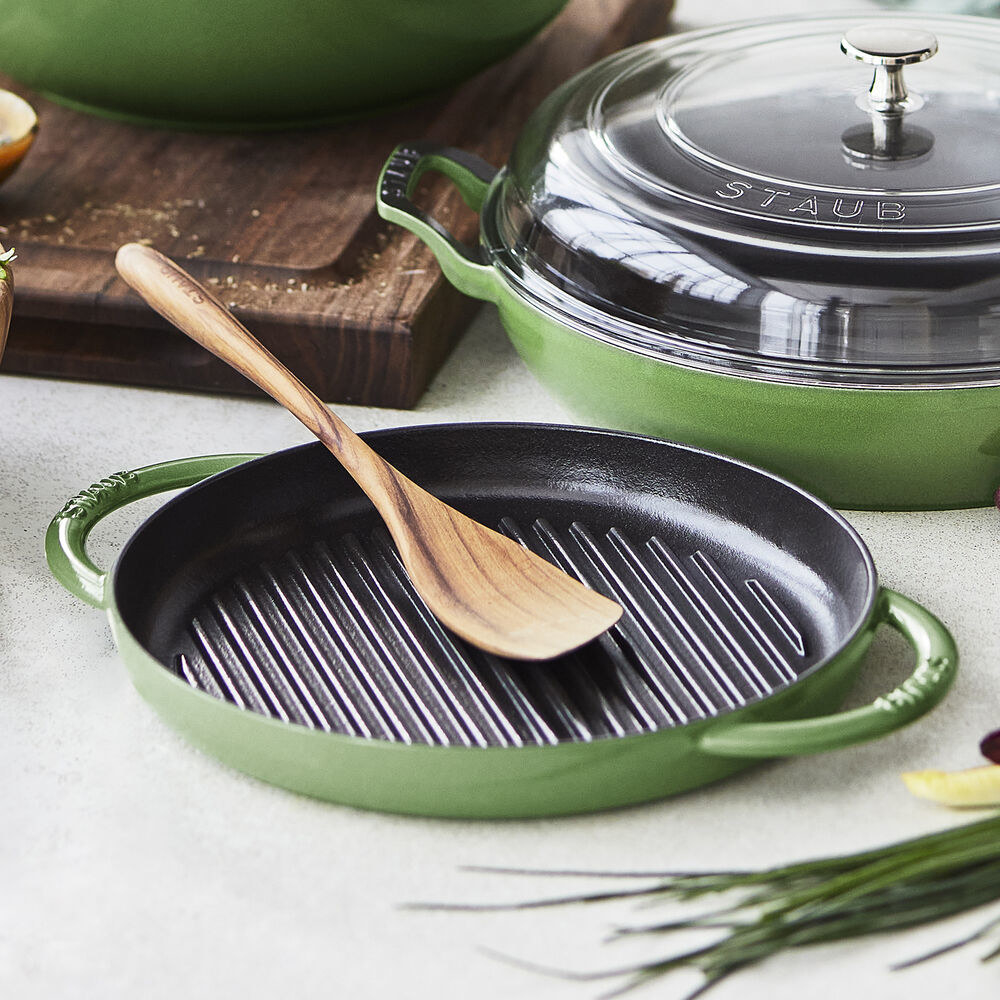 The green grill pan shown with a spoon in it
