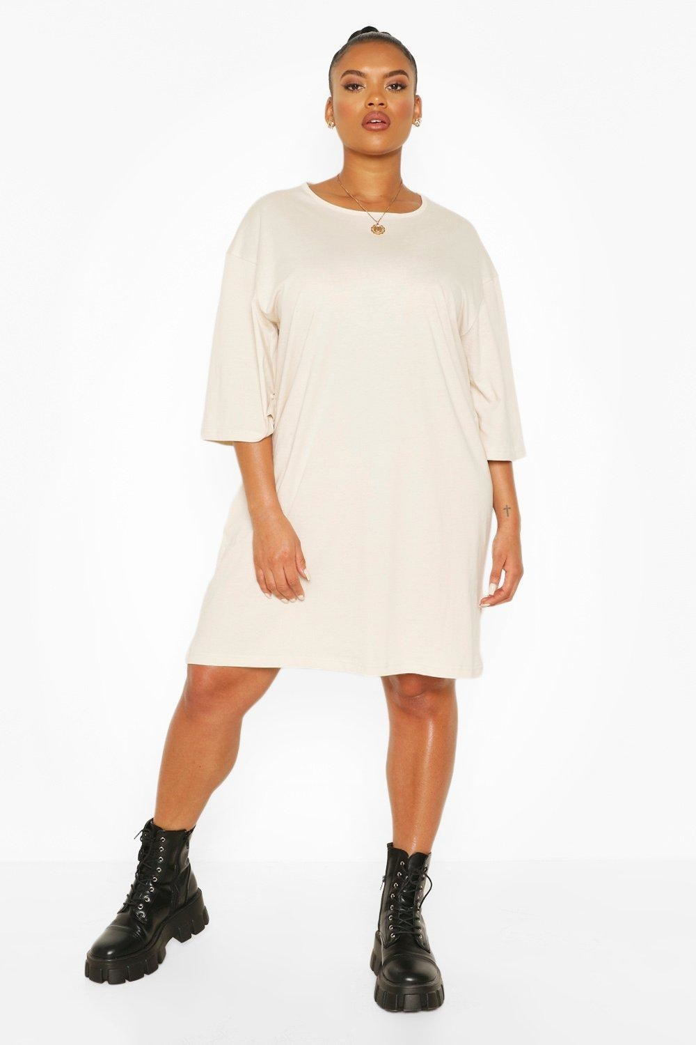 A model wearing the cream-colored T-shirt dress that goes to her knees