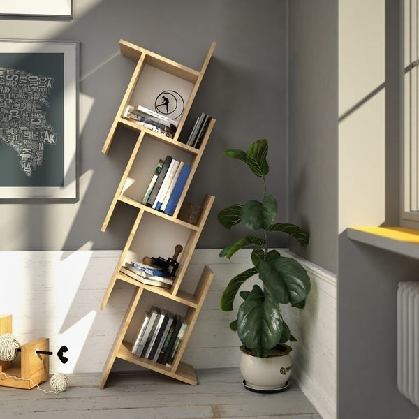 light wood bookcase of four stacked cube compartments that are slightly tilted for a cool geometric effect