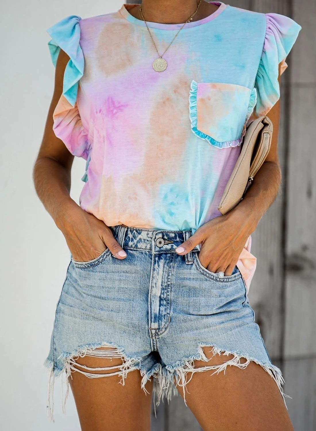 A closeup of a model wearing the tie-dye ruffle tank top