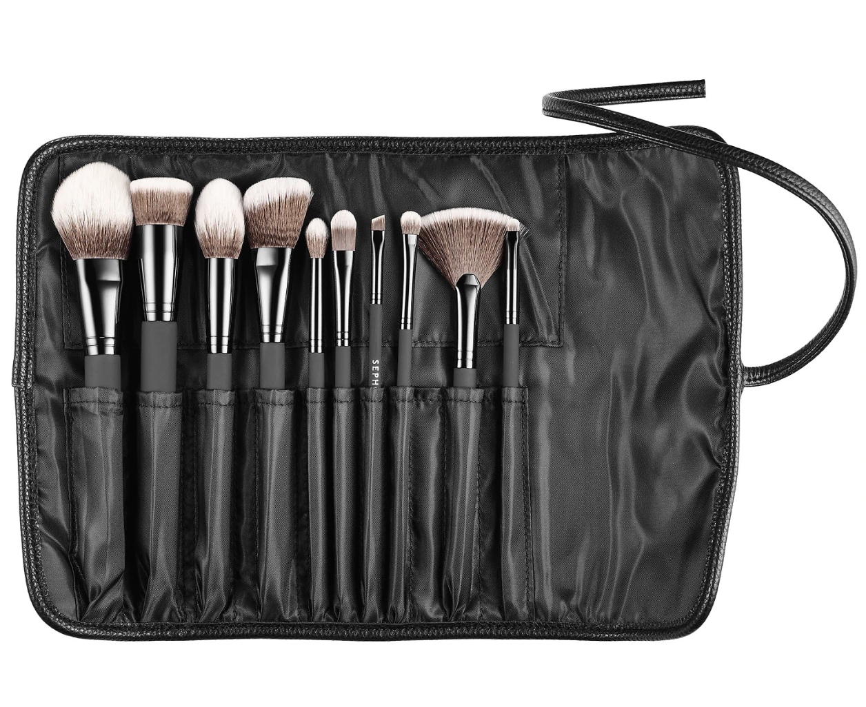 Four fluffy brushes, five smaller brushes, and one fanned brush tucked into individual pockets in the carrying case