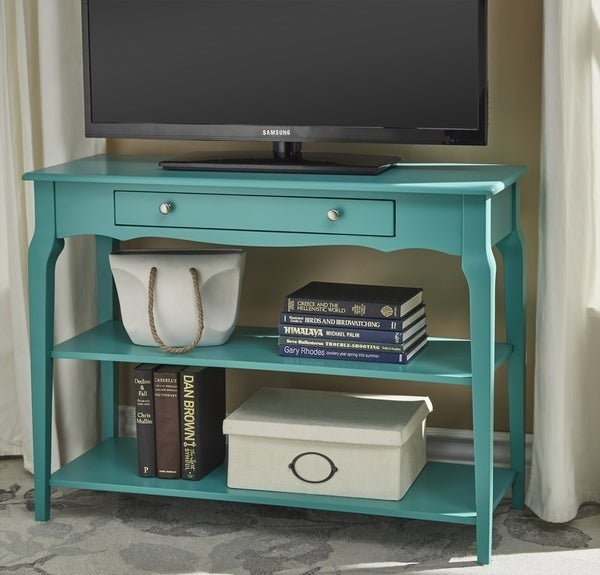teal TV console with one pull out drawer with silver knobs, two long open shelves on the bottom