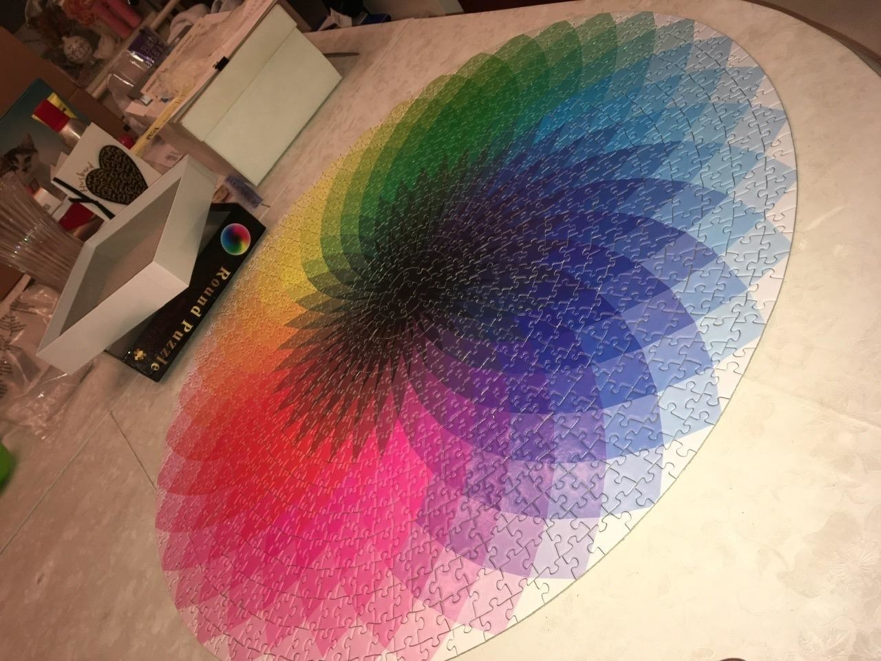 A reviewer image of the completed puzzle. The circle has a fan of different colors with a black center