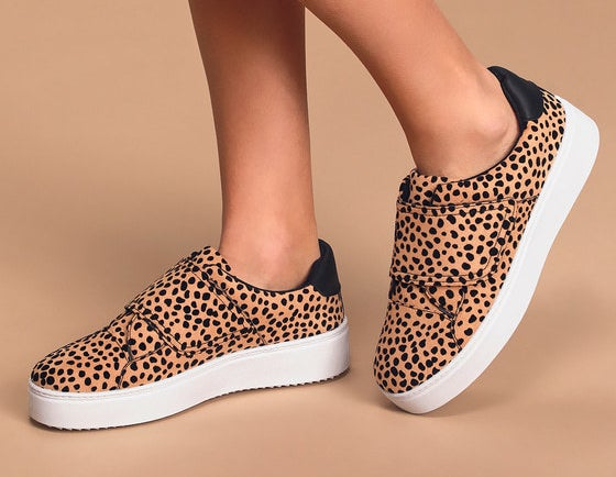 """Closeup of flatform sneakers with a 1.25"""" platform, a velcro closure, and a tan and black leopard print"""