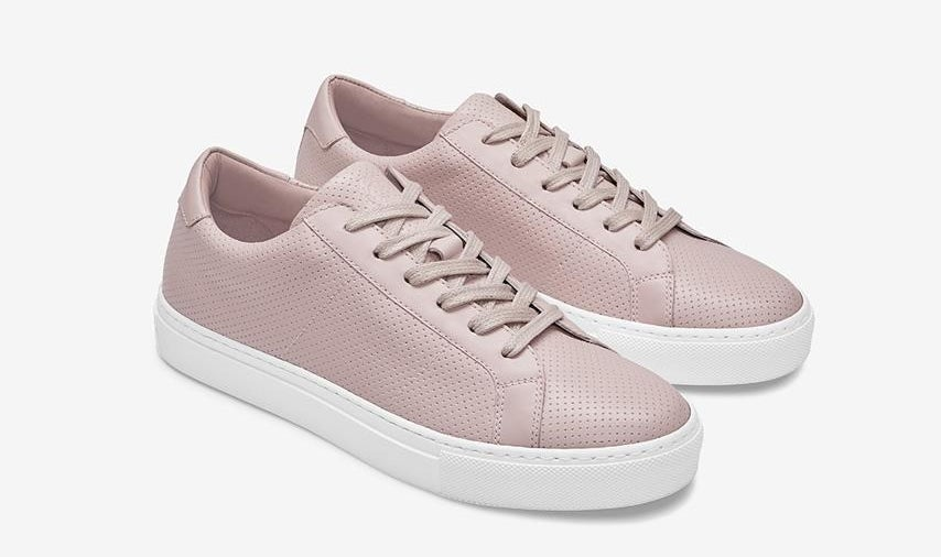 The perforated sneakers in light pink with matching laces and thick white soles