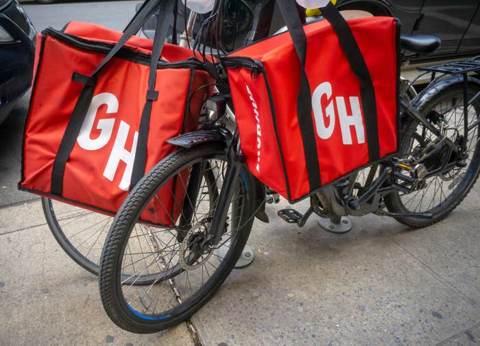 A bicycle with GrubHub delivery bags