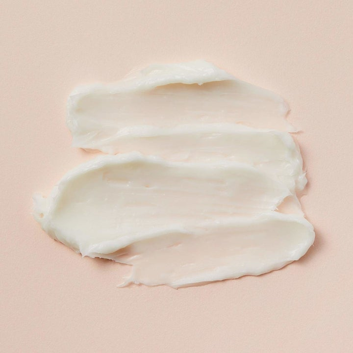 The same face cream's formula spread out to show its whipped, creamy texture